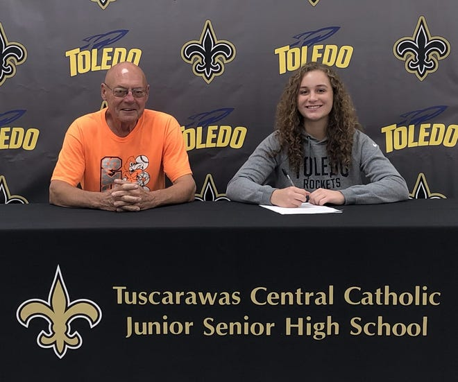 Sophia Knight, a senior at Tuscarawas Central Catholic, signed a letter of intent to attend Toledo University where she has received a scholarship to pitch for the Rockets softball team. Knight plans to major in Pre Med and enter into the Optometry program. She is the daughter of  Jerry and Nichole Knight. Pictured with Knight is her longtime pitching coach Duck Krantz.