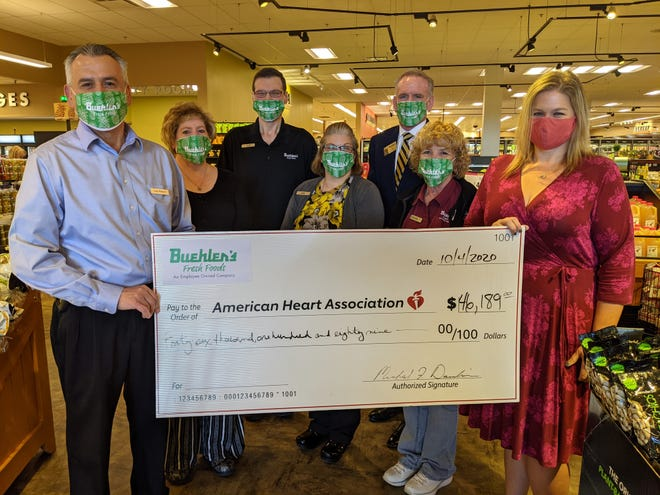 Buehler's Fresh Foods donated $46,189 from its fundraising campaign to the American Heart Association. Pictured, from left: Wooster Milltown store manager Andy Williams, Wooster Milltown Services and Facilities manager Joyce Keener, Wooster Towne Market cashier Jeff O'Dell, Wooster Towne Market store manager Jody Dawson, Executive Vice President of Sales and Marketing Mike Davidson, Wooster Milltown cashier Wanda Zimmerman and Jenn Fortney.