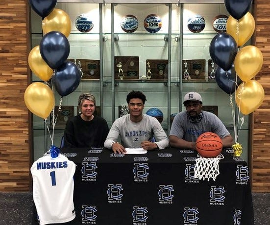 Harrison Central senior Kobe Mitchell signed his letter of intent to attend and play men's college basketball at the University of Akron. Mitchell, who is flanked by his parents, is the all-time leading scorer at Harrison Central.