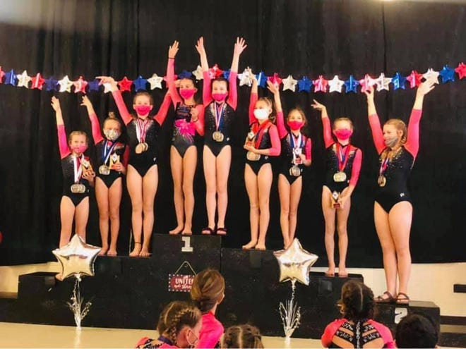 Edgewater Gymnastics first place Team USA Gymnastics Xcel Gold, from left: Jillian Pitts, Camryn Hlbiski, Olivia Tidwell, Haydyn Ward, Alivia Bennett, Mikala Holmes, Abbi Ellis, Gypsi Rapisardi, Addison Woodham.