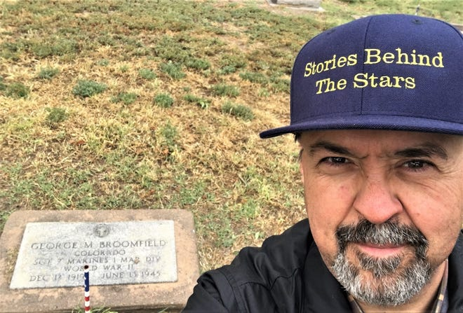 "Don Milne at the grave of George M. Broomfield in the Las Animas Cemetery. Broomfield is one of the fallen whose biography is part of the ambitious ""Stories Behind the Stars"" memorial project."