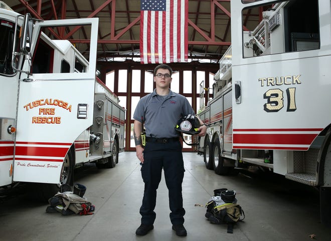 Tristan Williams is a rookie firefighter with Tuscaloosa Fire Rescue and is the first graduate of the TCTA firefighter program to be employed as a Tuscaloosa firefighter. Williams stands in the apparatus room at Fire Station 1 Tuesday, Nov. 10, 2020. [Staff Photo/Gary Cosby Jr.]