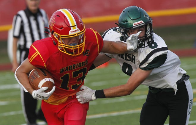 Worthington Christian's Ethan Albert holds off Fisher Catholic's Alex Smith during their game Sept. 10. Albert helped the Warriors finish 7-2 overall and 5-1 in the MSL-Cardinal Division.