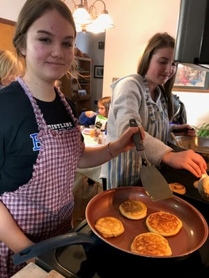On Nov. 12, 2019, Abi Chester and Clareese Prenger made pumpkin pancakes for junior garden club members. One year later, with social distancing in place, members are unable to cook and eat together.