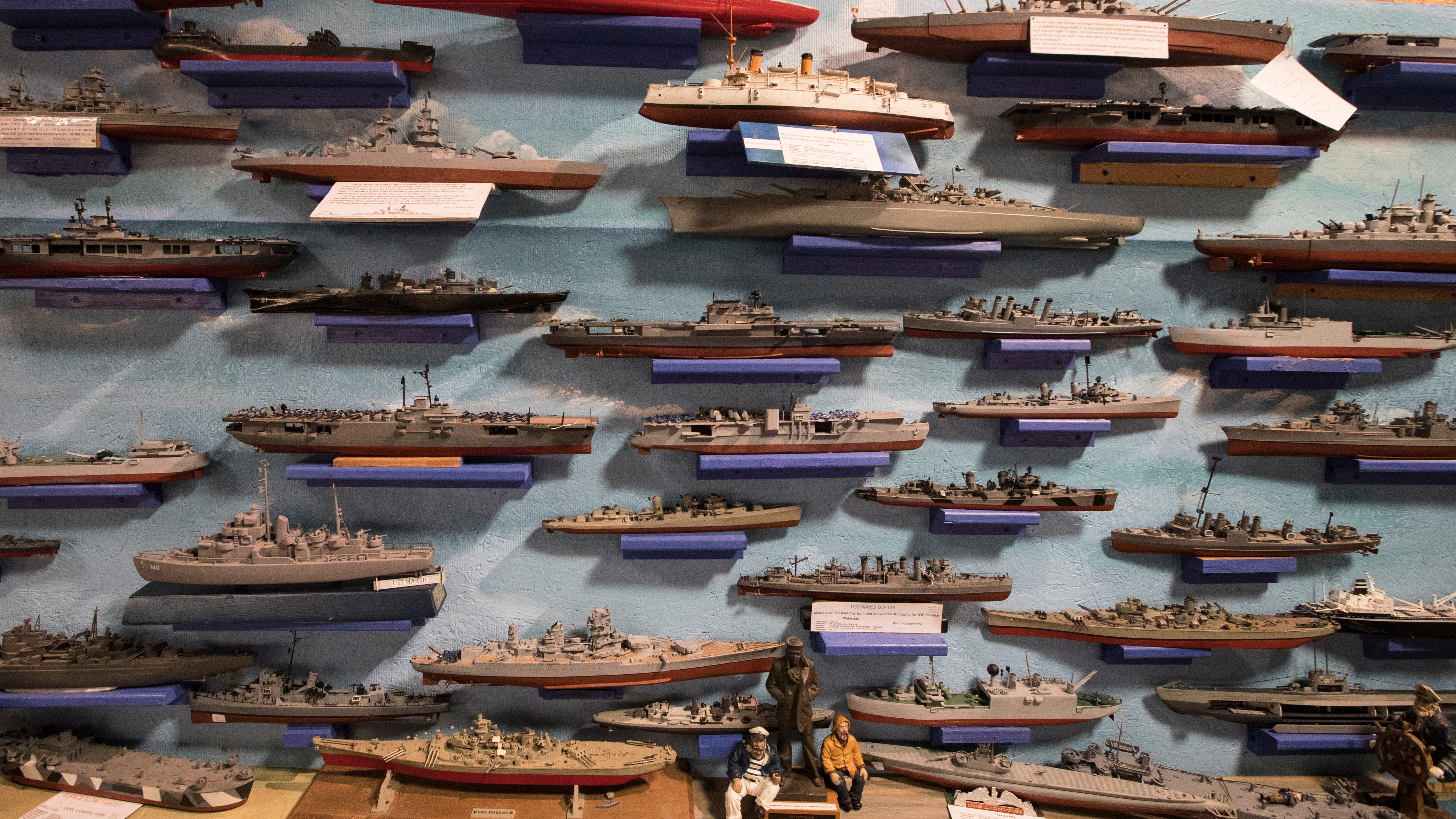 Model battle ships decorate the walls at the newly relocated Southwest Florida Military Museum. The museum has found a new home and will be opening soon at the former Disney store at Edison Mall.