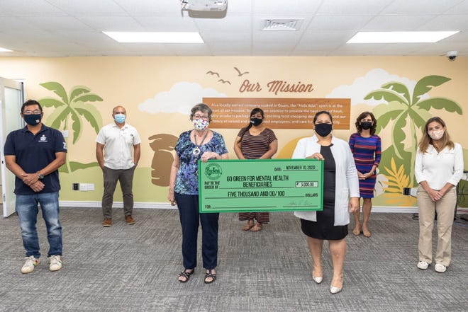 From left to right (front row): Victor Camacho, Sanctuary Inc. executive director; Karen Carpenter, Victim Advocates Reaching Out office  manager; Bernice McGill, Gametime Inc. program director; Marie Benito, Pay-Less Community Foundation president. From left to right (back row): Mike Benito, Pay-Less general manager; Leinani Naholowa'a Catholic Social Services: Alee Shelter program manager; Kathy Calvo, Pay-Less president and chief executive officer.