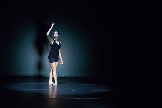 "Tatum Beynon is one of the dancers in the University of Iowa's 2020 Dance Gala. Beynon is shown performing in ""Foramina,"" a piece choreographed by Britt Juleen."