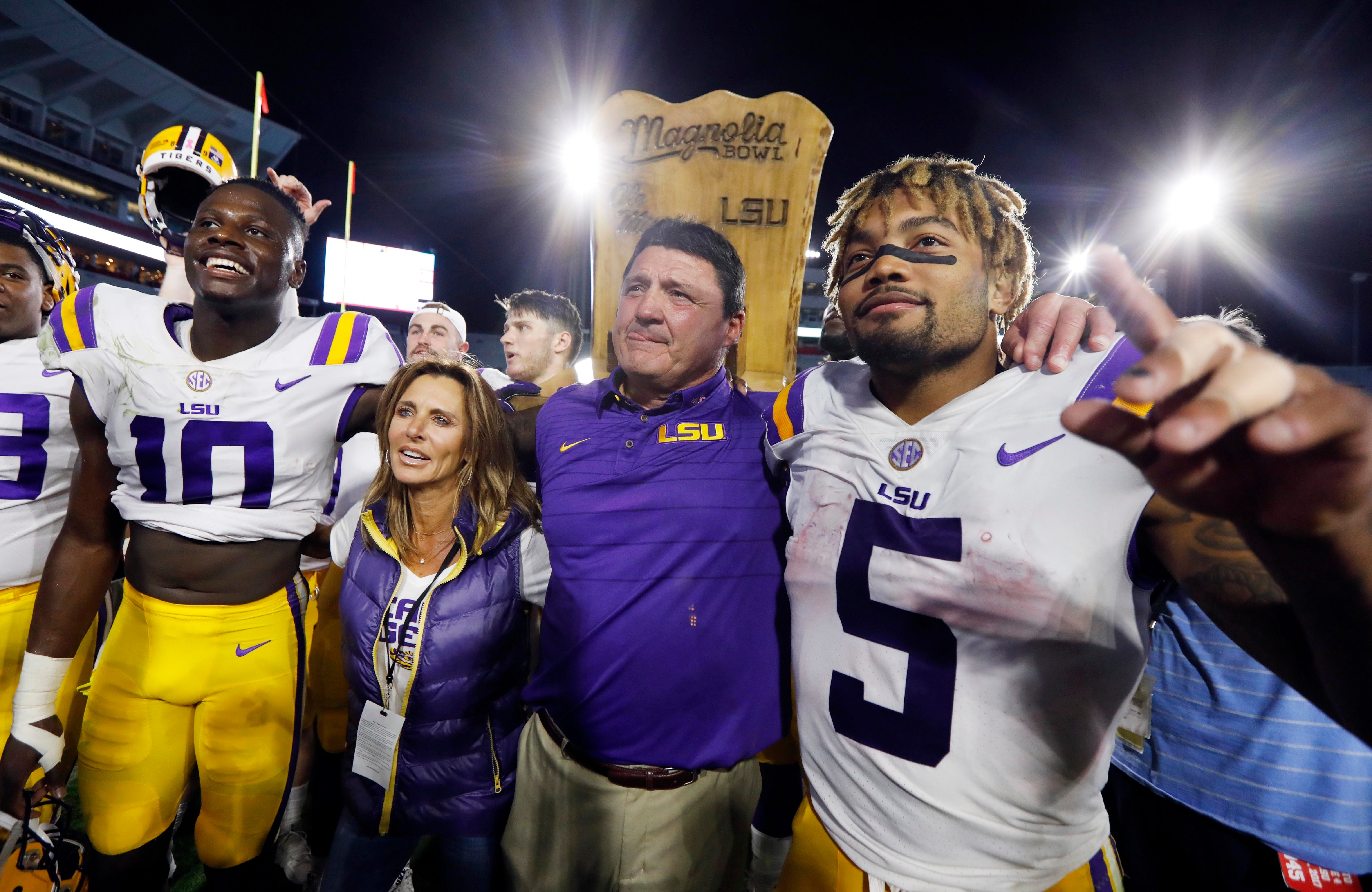 Derrius Guice, right, with LSU coach Ed Orgeron.