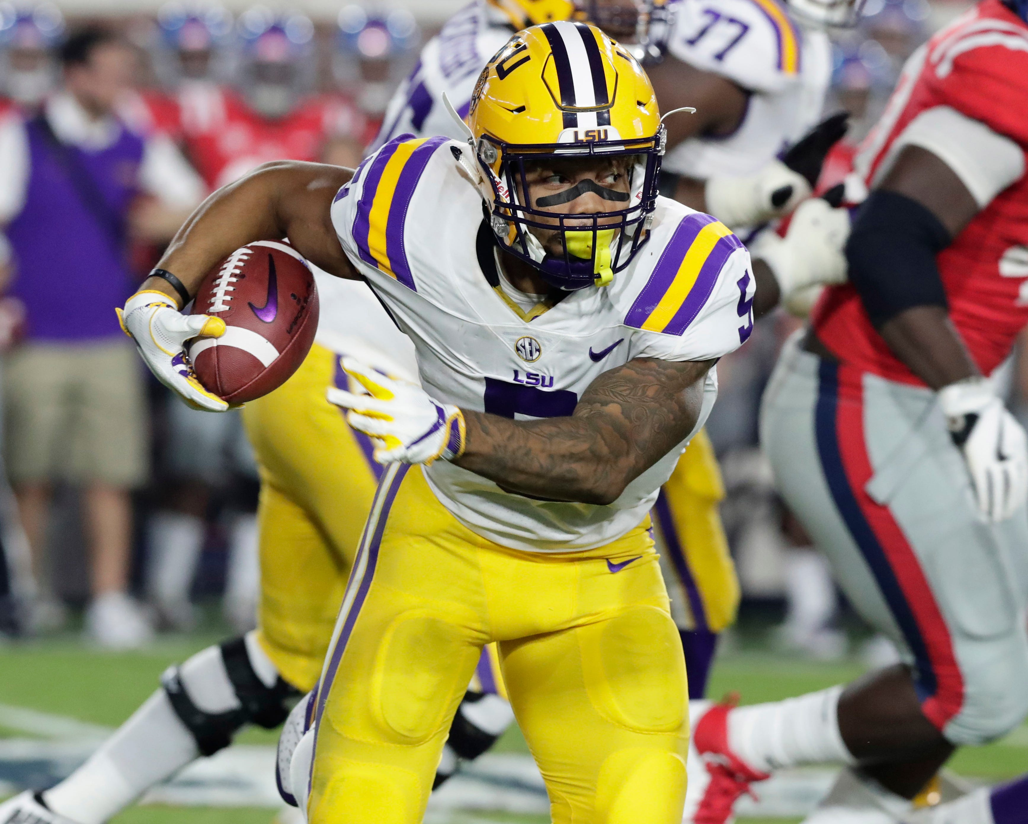 In this 2017 file photo, LSU running back Derrius Guice plays during an NCAA college football game in Oxford, Miss.