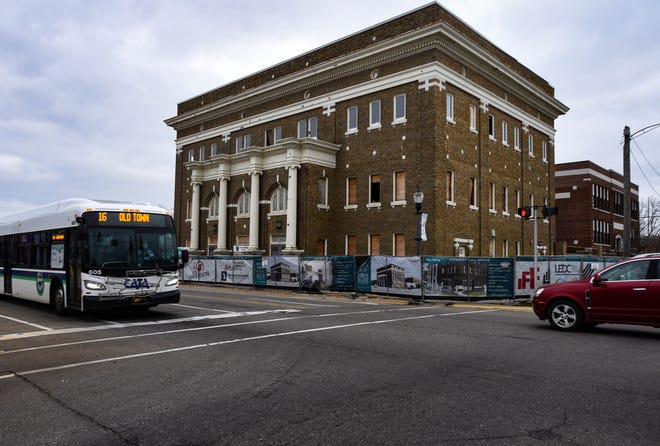 Work is underway at the Temple Building in Old Town on Wednesday, Nov. 11, 2020.