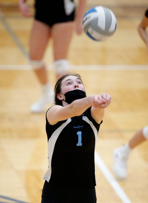 Lansing Catholic's Hailey Bres sets against Blissfield, Tuesday, Nov. 10, 2020, at Lakewood High School.