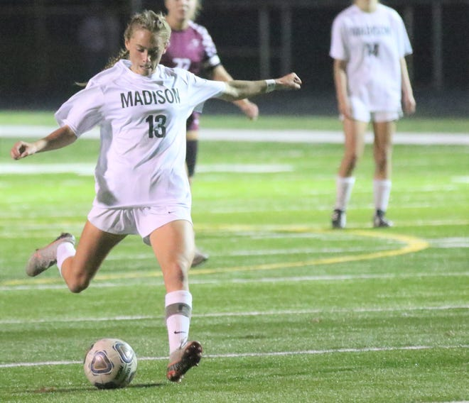 Madison's Taylor Huff delivers a perfect strike for one of her three goals during the Rams' 4-2 Division II state semifinal victory over Rocky River. Huff was named the United Soccer Coaches National High School Girls Scholar Player of the Year.
