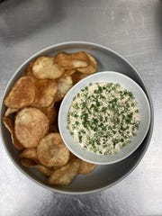 The house chips and French onion dip is one of the shareable small plates at Oggie's, which recently reopened at Hotel Metro downtown.