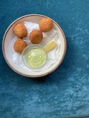 Cauliflower croquettes are served with tarragon dressing at Oggie's. They're one of several small plates to have with drinks.