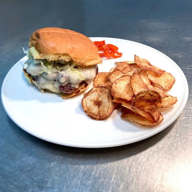The Oklahoma onion burger is one of five sandwiches at Oggie's, 411 E. Mason St. It's based on a burger at Sid's Diner in El Reno, Oklahoma.