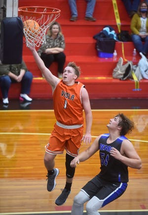 Viola's Bryson Luna scores two of his 21 points on Tuesday night against Ozark Mountain.