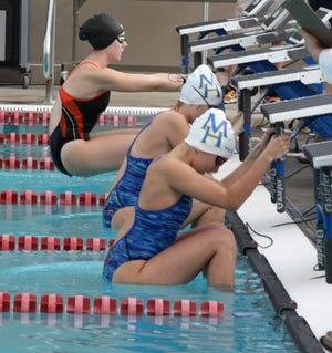 Mountain Home's Sierra Trogdon and Olivia Wham lead off during the medley relay on Tuesday at Batesville.