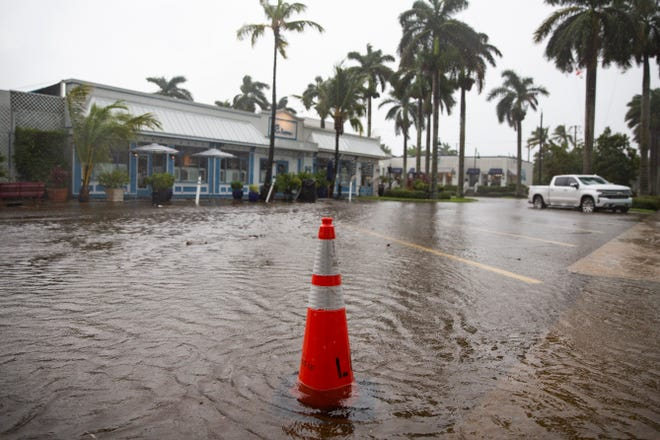 Flood waters cover the road along 8th Street South in Naples on Wednesday, November 11, 2020.