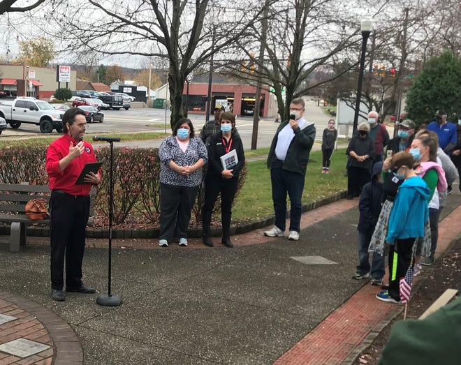 Doug Stout, veterans project coordinator for the Licking County Public Library, speaks to a crowd during last year's Veterans Day event at Veterans Park in Newark. Stout received the Ohio Library Council's 2021 Service Excellence Award for his service to the community.