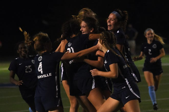 The unbeaten Granville girls soccer team celebrates its 3-2 overtime win against Monroe in the Division II state semifinals Tuesday at Xenia's Doug Adams Stadium, reaching their third state title game.