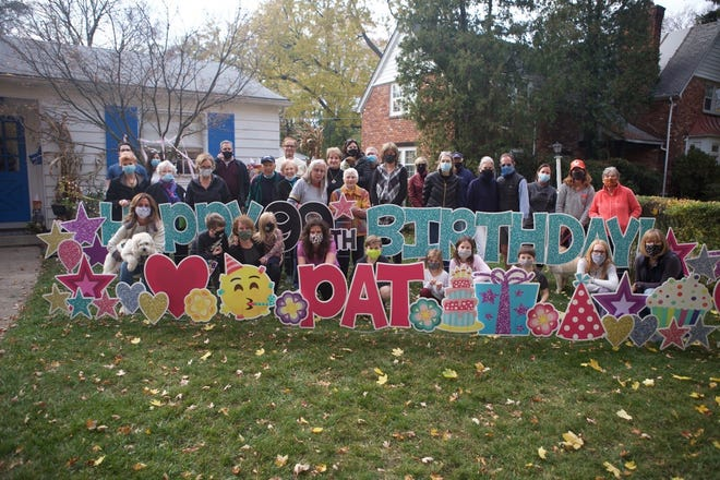 A happy crowd of friends, colleagues, yard decorators, neighbors, and relatives gathered to help Pat Andrews celebrate her 99th birthday. Many had been a part of the motor parade led by a fire engine manned by her friends, the Birmingham firemen.