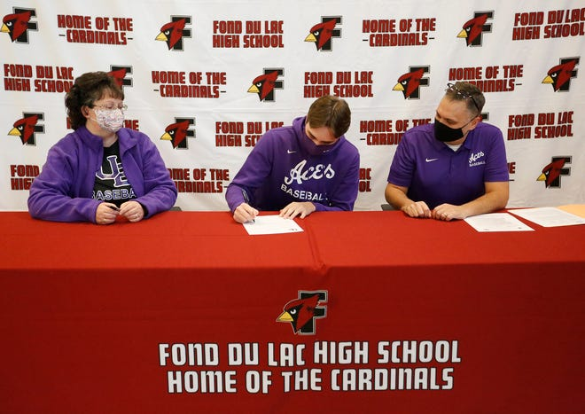 Fond du Lac senior Ryan Schneider is joined by his parents Julie and Cory on Wednesday at Fond du Lac High School as he signs his NCAA Letter of Intent to play Division I baseball at the University of Evansville in Indiana as a pitcher.