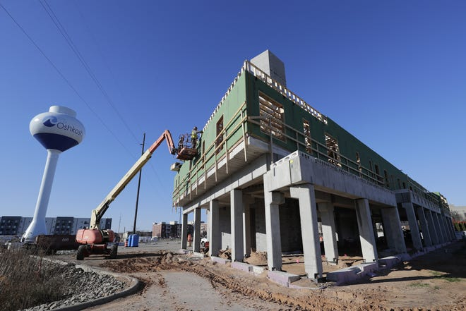 Construction crews work Wednesday, Nov. 11, 2020, on the Brio Building at Marion Road and Jackson Street in Oshkosh. The building will house the new Oshkosh Food Co-op.