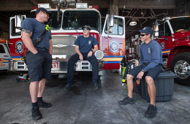 From left, Firefighter EMT Thomas Bradley, Firefighter EMT James Southern, and Firefighter/Paramedic Jason Coutler chat during down time at Escambia County's Pensacola Beach Fire Station #13 on Tuesday, Nov. 10, 2020.