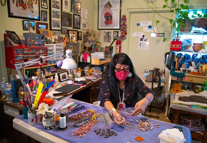 Yolanda Hart Stevens, Pee Posh artist, makes Native American regalia at her home in the Gila River Indian Community.