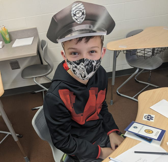 Daniel Baker, a Port Clinton Middle School student, showcases the small gifts he received in response to a letter of his own he sent to the Lake Charles Police Department in Louisiana following Hurricane Laura thanking them for their service.