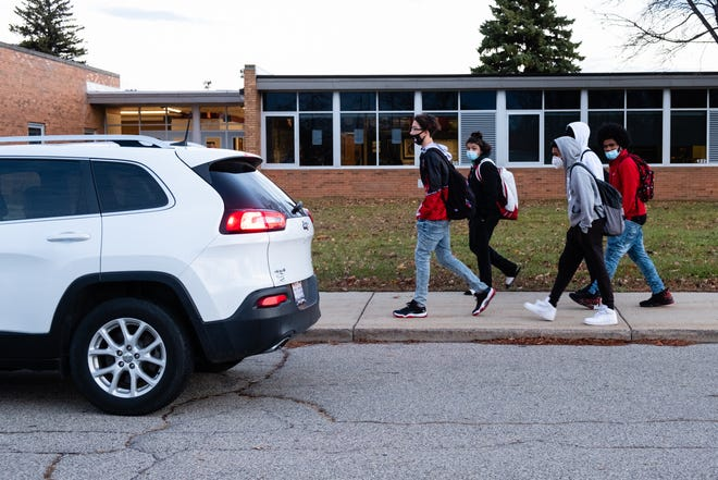 Students arrive at Port Huron High School before the start of school Wednesday, Nov. 11, 2020.