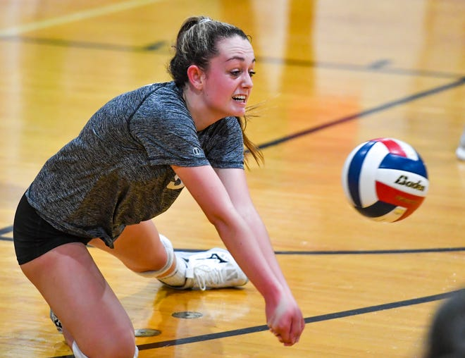 York Suburban's Kenzie Corsa digs a short Garden Spot serve on the line during game four of the District 3 Class 3-A girls' volleyball championship, Tuesday, November 10, 2020.John A. Pavoncello photo