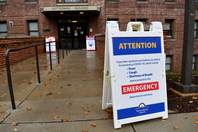 Signs at the entrances of the WellSpan York Hospital complex highlight the continued issues with the COVID-19 pandemic, Wednesday, November 11, 2020.John A. Pavoncello photo