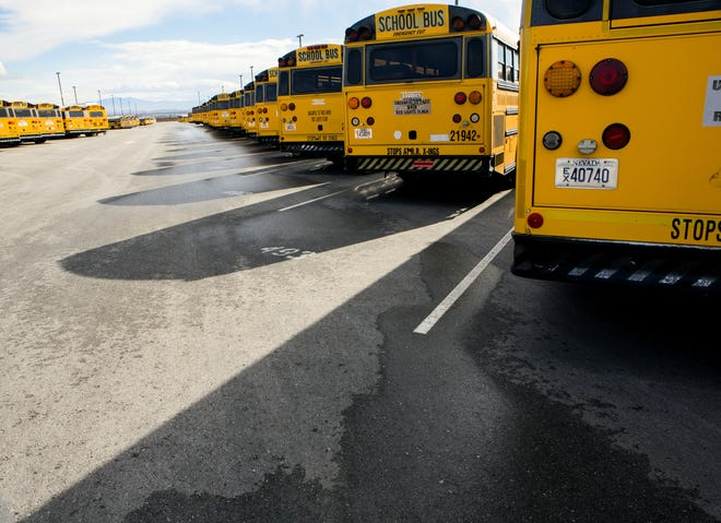 Rows of buses line up at Clark County School District bus yard.