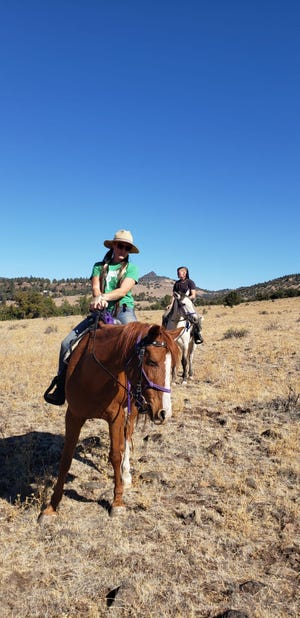 Left to right: Iron Gate Ranch owners Taryn McIntyre, 26, and Clair Shannon, 34, ride two horses they rescued and restored to health.