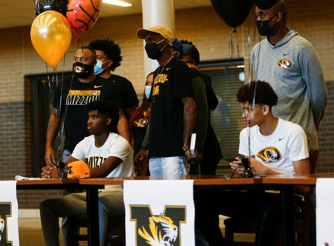 Kickapoo Chiefs basketball players Trevon Brazile (right) and Anton Brookshire before they sign their commitments to play at Mizzou on national signing day on Wednesday, Nov. 11, 2020.