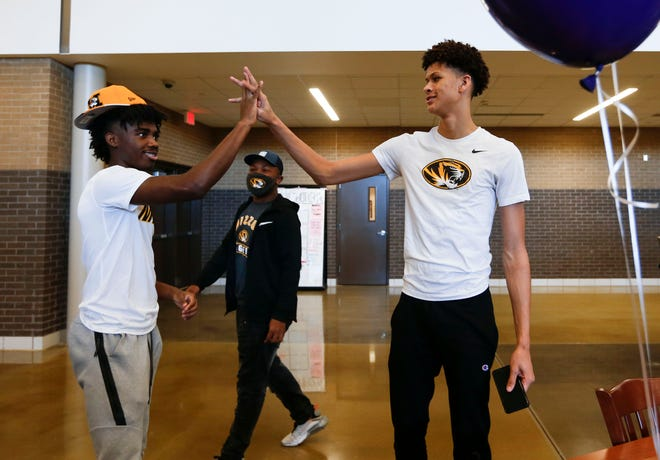 Kickapoo basketball players Trevon Brazile, right, and Anton Brookshire perform a handshake after both signed with Missouri on Wednesday in Springfield.