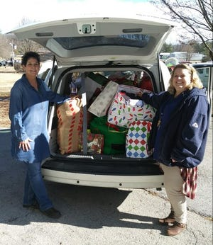 Community Center Coordinator Traci Burrow and  SeniorAge Administrator Lisa Arnold pack up a car to deliver gifts in 2019.