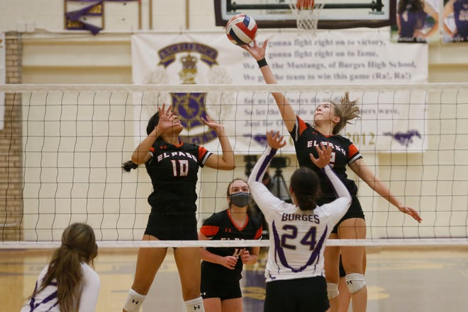 El Paso High's Yuliana Salazar, left, and Catalina Wong, right, during the game against Burges Tuesday, Nov. 10, at Burges High School in El Paso.