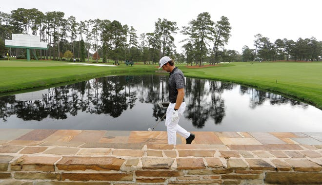Lanto Griffin walks along the pond on the 15th hole during a Masters practice round.