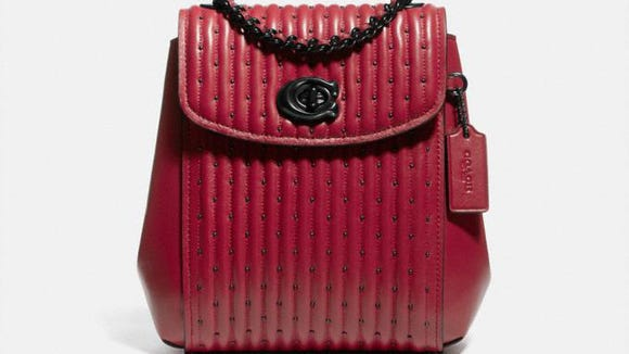 This edgy, riveted bag is a fun take on an old classic.