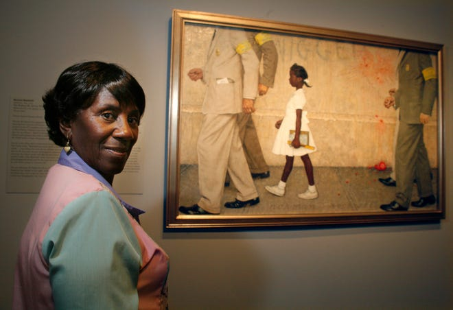 """In this July 20, 2006, file photo, Lucille Bridges poses next to the original 1964 Norman Rockwell painting, """"The Problem We All Live With,"""" showing her daughter Ruby, inside the Museum of Fine Arts in Houston. Bridges, a Hurricane Katrina evacuee and Houston resident after the storm, looked for the first-time at the Rockwell original capturing her oldest daughter, Ruby, as she was escorted by U.S. marshals into an all-white New Orleans school during integration nearly a half-century earlier. New Orleans' mayor announced Tuesday, Nov. 10, 2020, that Lucille Bridges, the mother of civil rights activist Ruby Bridges, has died at the age of 86."""