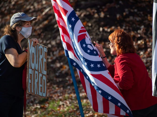 Anti-Trump and pro-Trump protesters on Nov. 7, 2020, at the Trump National Golf Club in Sterling, Virginia.