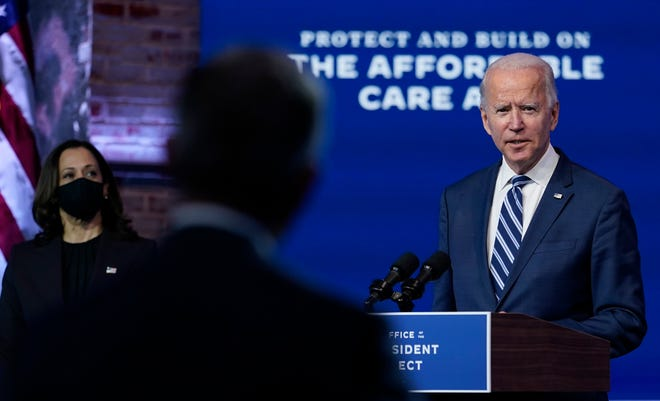 President-elect Joe Biden, joined by Vice President-elect Kamala Harris, answers a reporter's question at The Queen theater on Tuesday in Wilmington, Delaware.