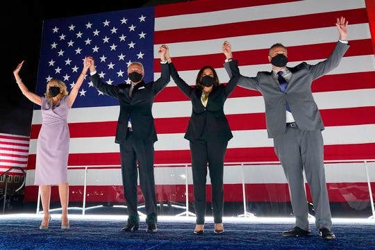 President elect Joe Biden, and his wife Jill Biden, with Vice President elect Kamala Harris and her husband Doug Emhoff in August at the Democratic National Convention at the Chase Center in Wilmington, Delaware.