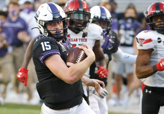 TCU quarterback Max Duggan (15) has rushed 37 times for 229 yards and four touchdowns in games the past two years against Texas Tech. The Red Raiders, coming off an uplifting win Saturday at West Virginia, are hoping to win as 1 1/2-point underdogs against the Horned Frogs on Saturday at Jones AT&T Stadium.