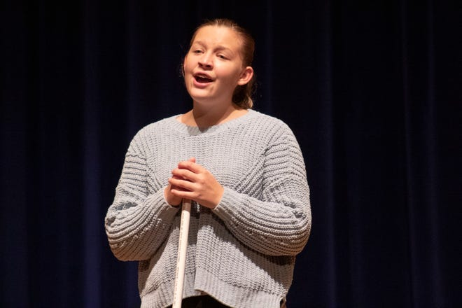 "Alliance High School student Josie Root sings Wednesday night during a rehearsal of the musical ""Edges."""