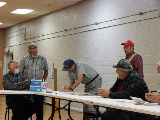 Director Ken Woode registers for his term while Ashland County Commissioner Denny Bittle and others observe. Pictured from left are Dan Stone, Bittle, Woode, Jim Beattie and Marty Wesner.