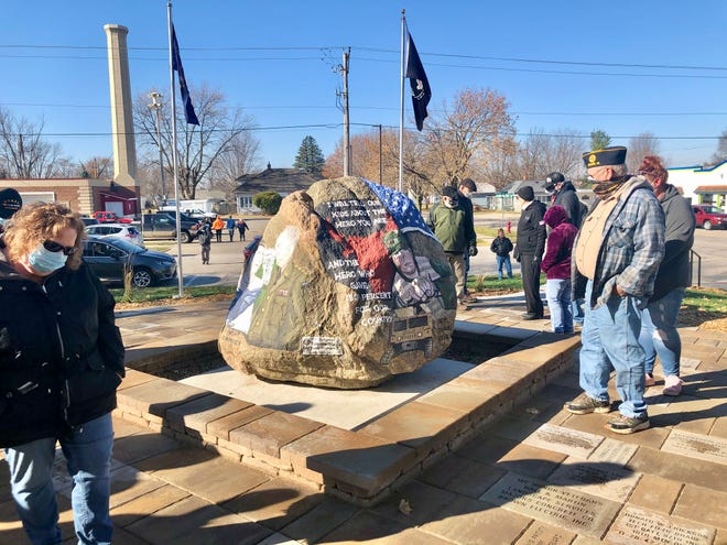 The Boone County Freedom Rock, located at the corner of W. Third Street and Main Street on the courthouse lawn, was dedicated on Veterans Day. Attendees gathered around the rock, taking pictures and visiting with friends and relatives — with silent remembrances of the lives lost during wartime.