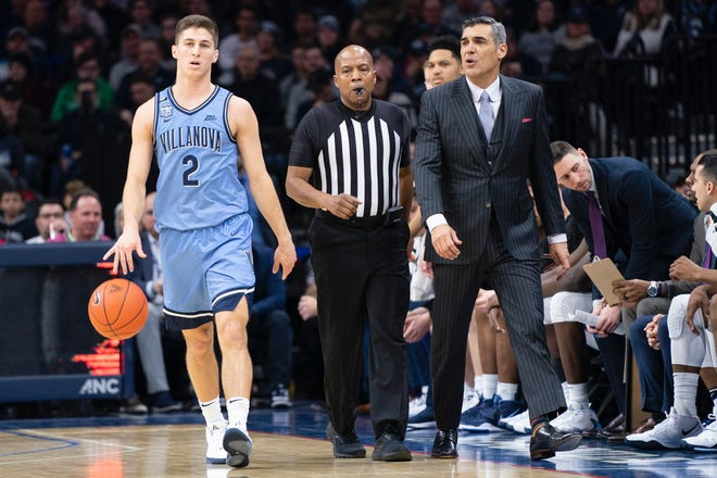 Villanova guard Collin Gillespie, an Archbishop Wood graduate, brings the ball upcourt as coach Jay Wright gives instructions.